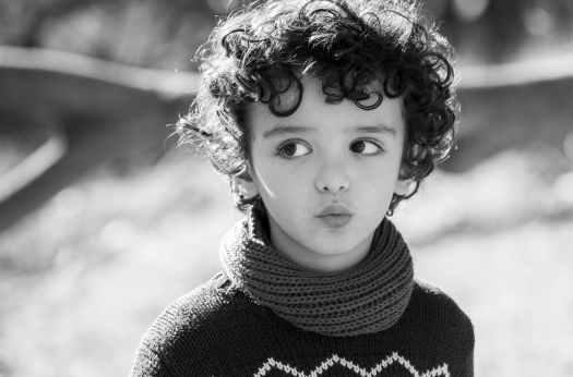 black and white blur child close up
